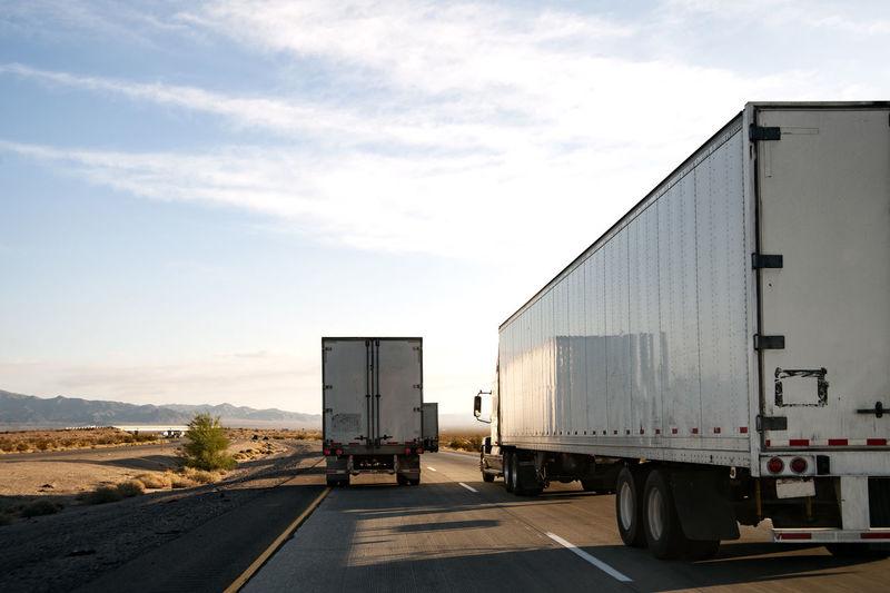 Eighteen wheelers trucking down the interstate