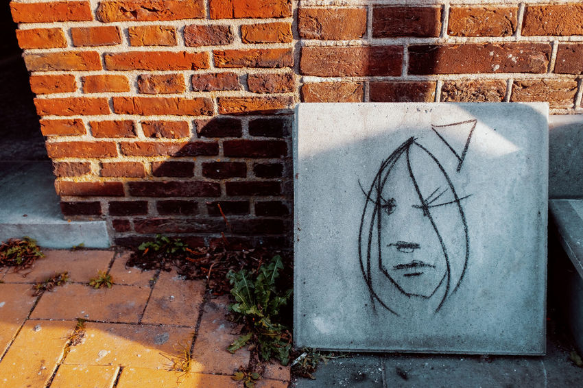 There she is! Brick Brick Wall Wall Wall - Building Feature Built Structure Architecture No People Building Exterior Creativity Day Graffiti Art And Craft Outdoors Communication Drawing - Art Product Footpath Sidewalk Craft Mural