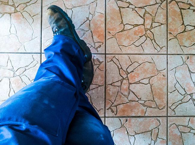 Tea Break Working Boots Boots Trousers Kneepads Tradesman Dirty Floor Floor Tiles Cracked Dirty Legs Boots Workman Human Body Part Feet Rest Break Lunch Crossed Legs