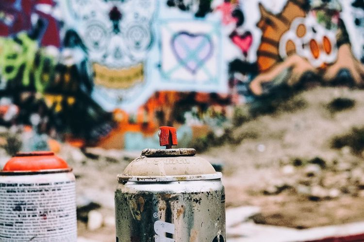 Art Backgrounds Creativity Cultures Damaged Depth Of Field Full Frame Graffiti Metal Multi Colored No People Rusty Selective Focus Spraypaint Wall Wall - Building Feature