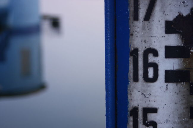Water Measurement Structure Water Reflections Architecture Blue Built Structure Close-up Communication Day Device Door Entrance Focus On Foreground Indoors  Instrument Of Measurement Measurement Metal No People Number Rusty Metal Safety Selective Focus Sign Text Wall - Building Feature