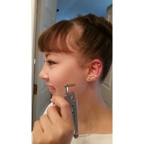 @lexiwdances bought a piercing gun online....That ear is gonna hurt like hell later :-) Piercehappy