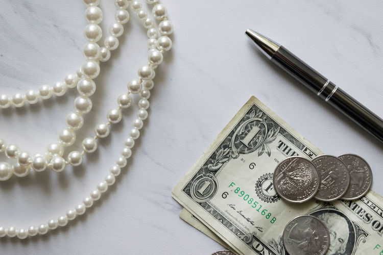 Elegant Green Money Money Money Sophisticated Work Class Close-up Currency Day Finance High Angle View Indoors  Marble Money No People Pearls Pen Silver Colored Sophistication Still Life Table Texture Wealth
