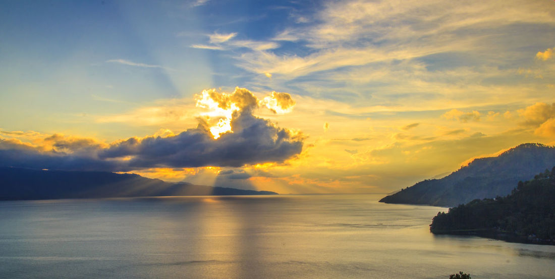 landscape of Indonesia : a dramatic sunset in Toba Lake North Sumatera. Portfolio Of Arif Wibowo Photograph By Jgawibowo Portfolio Of Jgawibowo Photography By Jgawibowo Sunset Sunset_collection Lake Twilight View Twilight Clouds And Sky Toba Lake Water Sea Mountain Sunset Sky Landscape Horizon Over Water