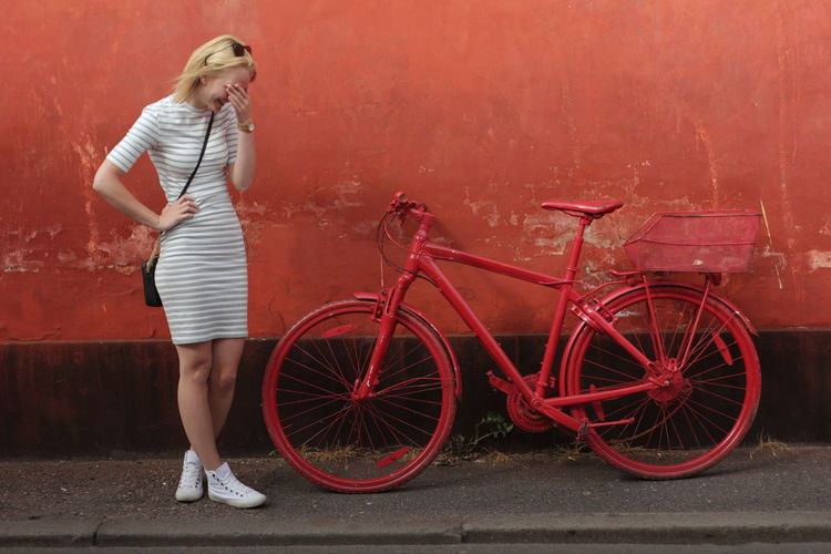 Color Contrast Girl Hanging Out Model Parked Parked Bicycle Playing Around Posing Red Bicycle Red Bicycles Red Color Stripped Dre Unusual Bicycle Wall White Dress