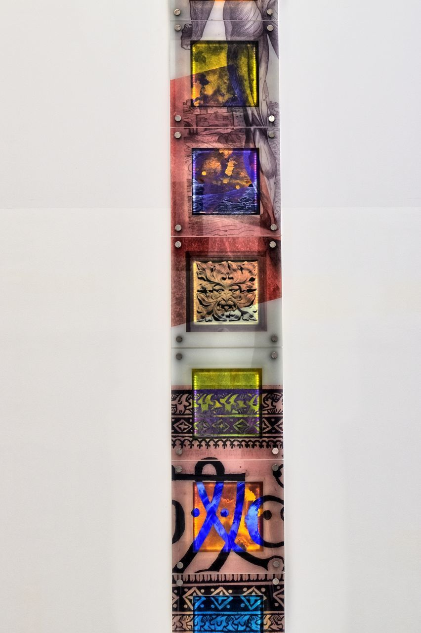 DIGITAL COMPOSITE IMAGE OF MULTI COLORED WALL IN GLASS