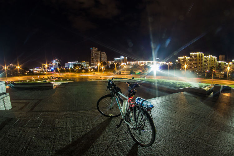 Belarus Minsk Architecture Bicycle Building Building Exterior Built Structure City City Life Cityscape Illuminated Land Vehicle Mode Of Transportation Motion Nature Night Office Building Exterior Outdoors Real People Riding Road Street Street Light Transportation Travel
