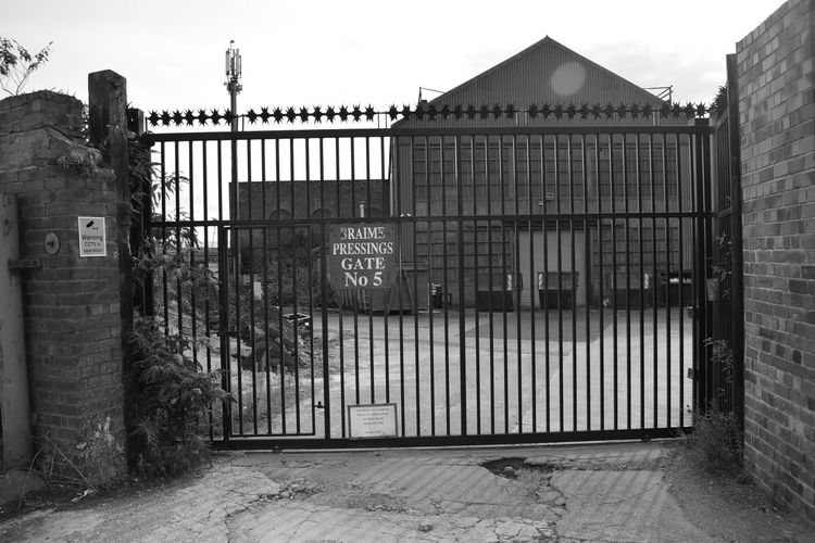 Gate 5 of Braime Sheet Metal Pressings, Hunslet, Leeds. Gate Industrial Photography Leeds, UK Architecture Back Of Building Black And White Photography Building Exterior No People