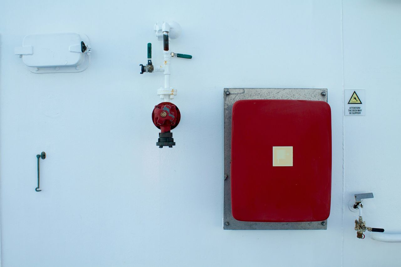 Low Angle View Of Red Equipment On Wall