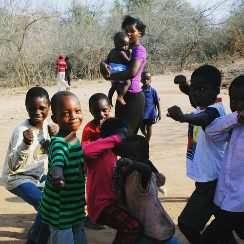 \Namibia, Africa\ Childhood Boys Girls Outdoors Smiling Happiness Friendship Playing Togetherness Enjoyment Spreadlove FeelTheMoment Having A Good Time Feelthefreedom