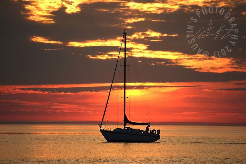 EyeEmNewHere Timing is everything Sunset Cloud - Sky Sky Sea Beauty In Nature Nature Orange Color Silhouette Scenics Sun Horizon Over Water Water Nautical Vessel Outdoors Beach Tranquility Tranquil Scene