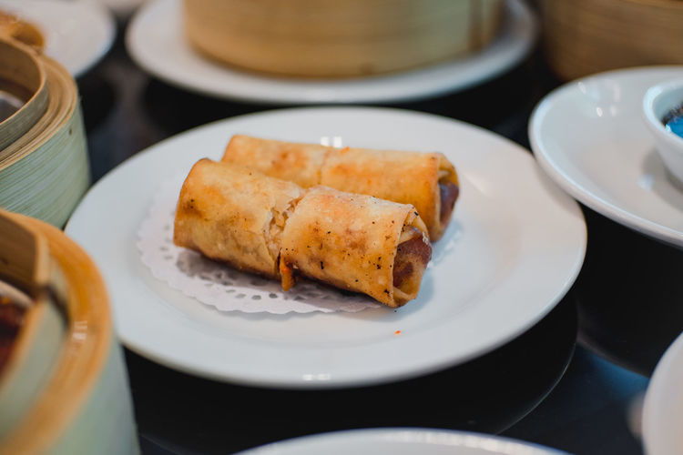 Close-up of dim sums served in plate on table