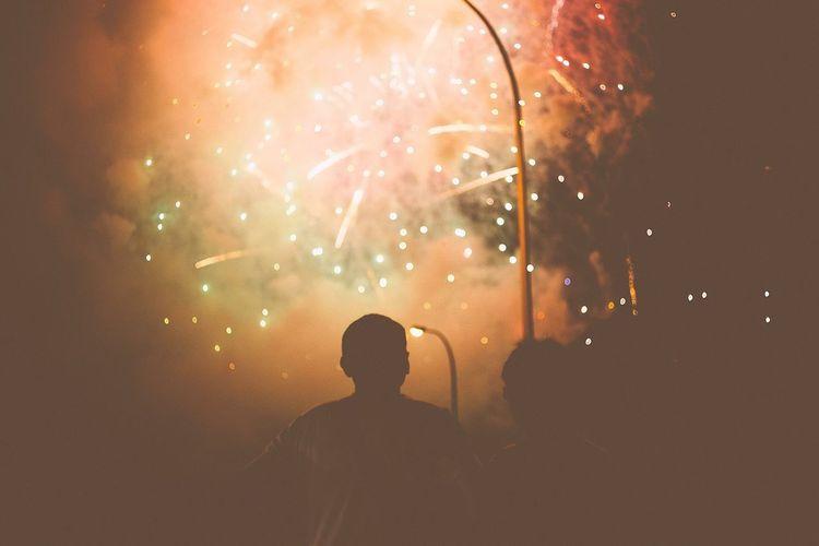 Silhouette men at watching firework display