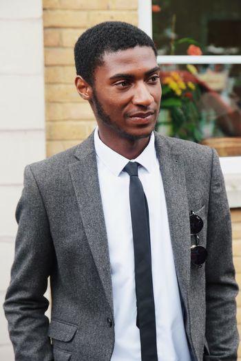Businessman in full suit looking away