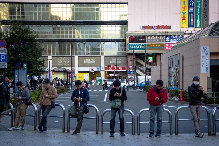 EyeEm Gallery EyeEmNewHere Japan City Life Group Of People People Streetphotography Using Phone Waiting