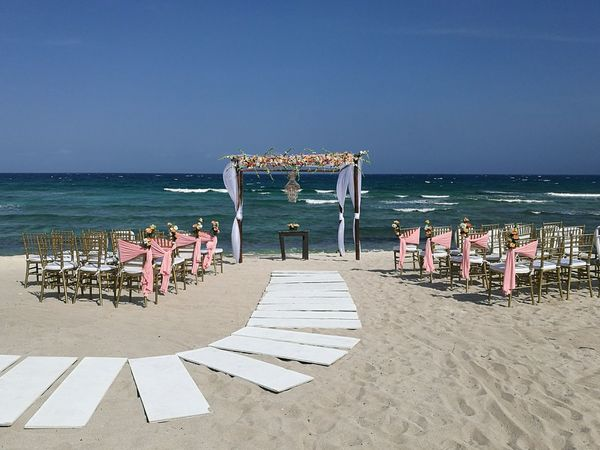 Beach Sea Horizon Over Water Water Summer Sand Vacations Outdoors Day Travel Destinations Nature Wave Sky No People Flower Centerpiece Beauty In Nature Floral Arrangemet Beach Wedding Weddingday  Nature Wedding Decoration Floral Arrangment Gazebo And Nature Gazebo On The Beach