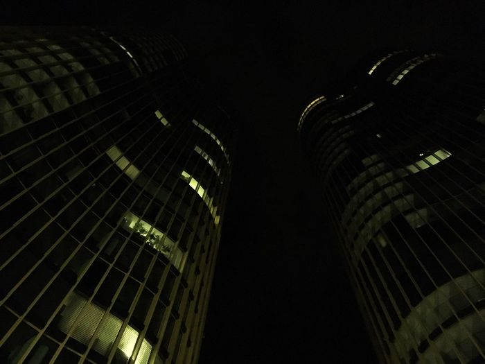 Low angle view of illuminated skyscrapers