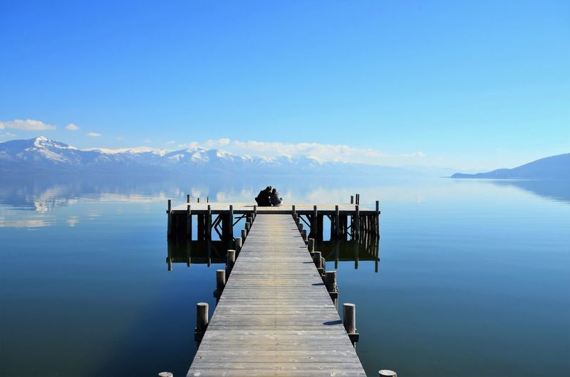 romance on a pier , lake prespa in macedonia Couple Hug Lake Ohrid Macedonia Man Romance Romantic Sunny Woman Young Day Idyllic Lake Lake Prespa Mountain Nature Outdoors Pier Scenics Sky Togetherness Tourism Tranquil Scene Water