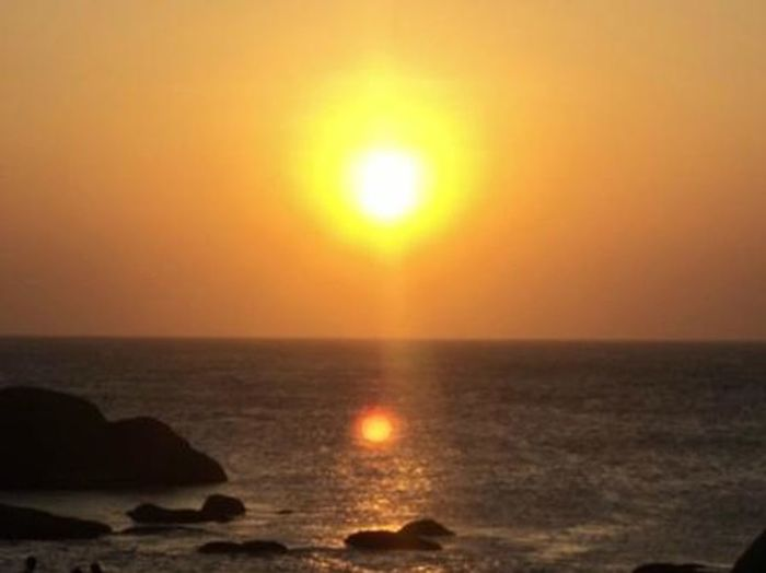 It is a SUNSET at Kanyakumari southern tip of India where three seas are united. ie bay of Bengal,Arabian sea, Indian ocean. Sunset