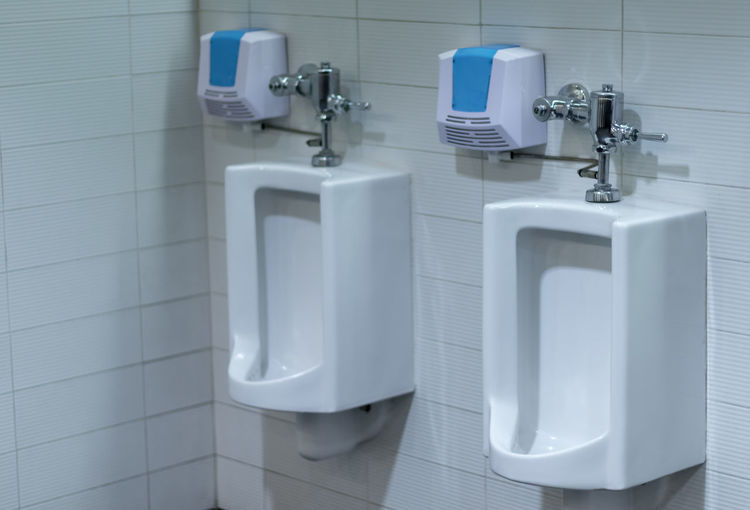 Bathroom Hygiene Public Restroom Indoors  Toilet Tile Domestic Bathroom Urinal Public Building Flooring Home No People Sink Domestic Room Faucet White Color Blue In A Row Household Equipment Absence Clean Tiled Floor