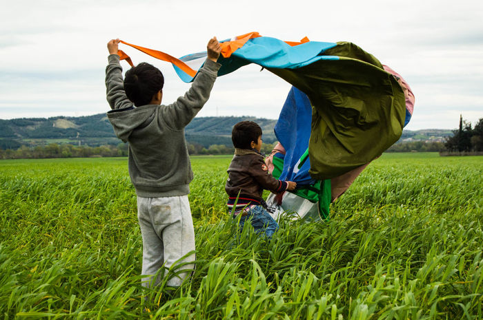 Afghan Chidren Fields Flying Fun Game Grass Green Joy Kite Refuge Syrian Tent Wind