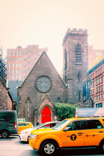 New York, USA - 27 September, 2016: The Church of the Holy Communion and Buildings are historic Episcopal church buildings at 656-662 Avenue of the Americas (Sixth Avenue) at West 20th Street. Architecture Church Church Of The Holy Communion Episcopal New York New York Cab Architecture Building Exterior City Episcopal Church History Landmark Mode Of Transport Outdoors Sky Transportation Tree Yellow Taxi
