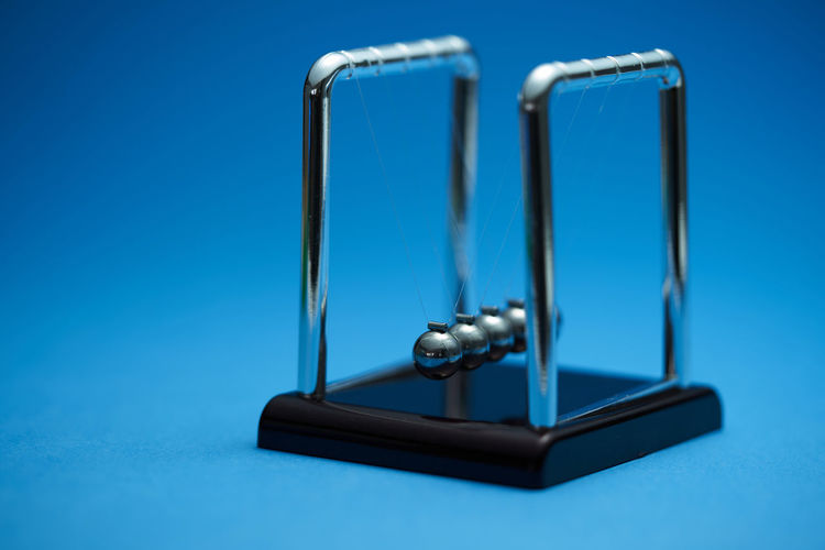 Close-up of smart phone on blue table