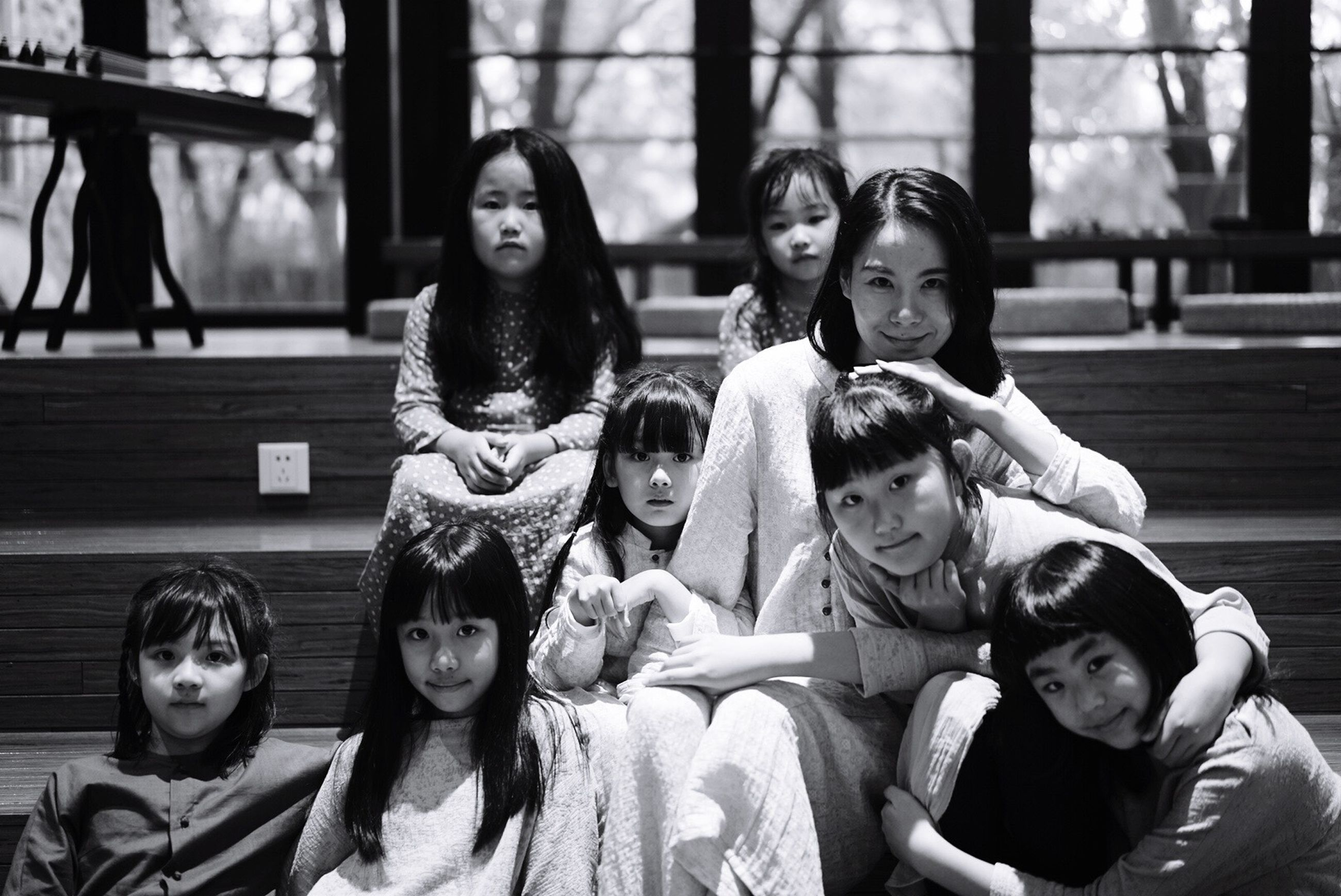 togetherness, bonding, love, leisure activity, lifestyles, smiling, girls, happiness, childhood, casual clothing, portrait, boys, sitting, looking at camera, family, focus on foreground, friendship, fun, person, enjoyment, day