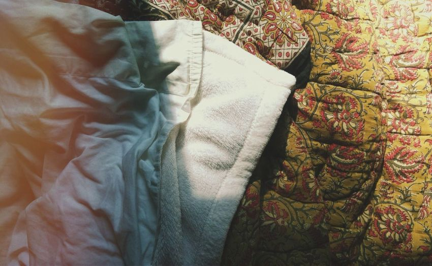 High Angle View Of Crumpled Blanket On Bed