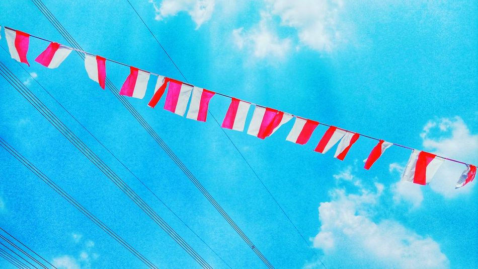 Our flag doesn't flutter because the wind moves it. It flutters with the last breath of soldiers who fought for our Independence. Happy Independence Day, Indonesia. NKRI HARGA MATI. Blue Sky Simplicity Simple Beauty Skyphotography Independence Day MERAH PUTIH INDONESIA Industry