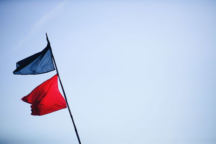 Red And Blue Canon Flags Clear Blue Sky