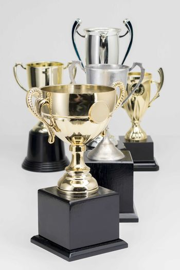Variety of Trophy Cup on white background Trophy AWARD Still Life Indoors  Success No People Achievement Metal Shiny Studio Shot Winning Close-up Table Cup Competition Gold Colored Wall - Building Feature Large Group Of Objects Single Object Silver Colored