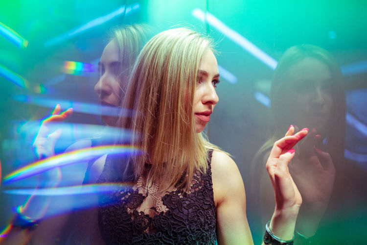 Illuminated Young Adult Young Women Music Real People Lifestyles Nightlife Beauty Women Enjoyment People Indoors  Light - Natural Phenomenon Hair Night Adult Nightclub Hairstyle Beautiful Woman Light Positive Emotion Clubbing Disco Dancing