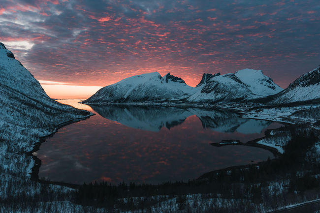 Sunset reflection of a fjord in Senja, a few hours from Tromso, Norway. Nature Sky And Clouds Water Reflections Beauty In Nature Cloud - Sky Cold Temperature Fjord Idyllic Landscape_photography Mountain Mountain Range Nature Nature_collection No People Orange Color Reflection Scenics - Nature Sky Snow Snowcapped Mountain Sunset Tranquil Scene Tranquility Water Winter