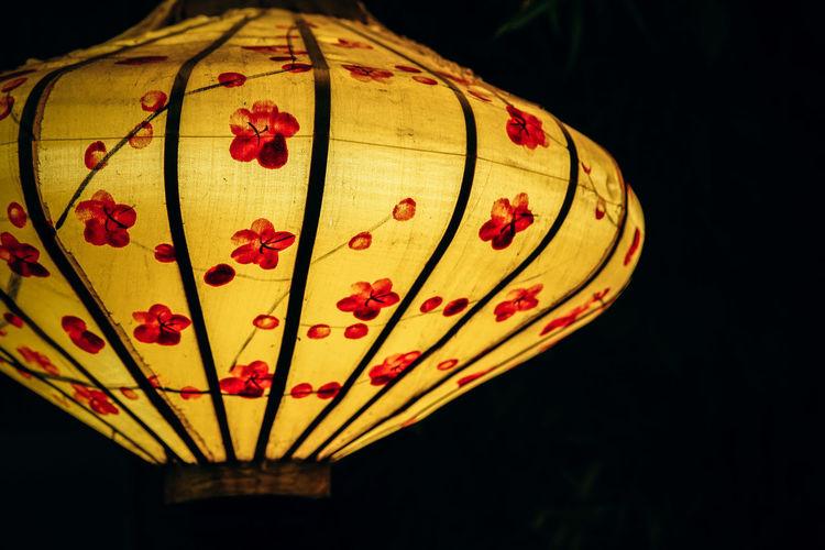Close-up of illuminated lantern against black background