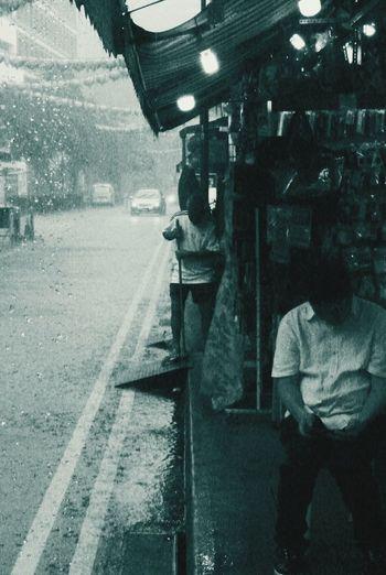 Life goes on Men People Livelihood Merchants Citylife Men Water Cold Temperature Winter Window Sky Rainy Season Rainfall Rain Under Wet Monsoon