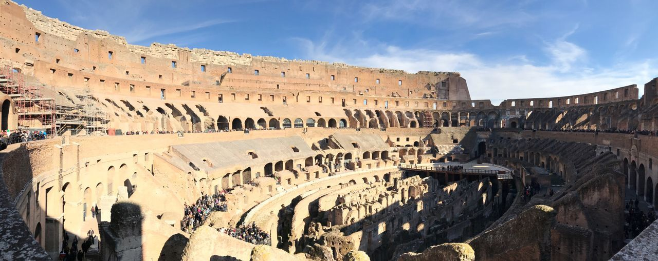High angle view of colosseum against sky on sunny day