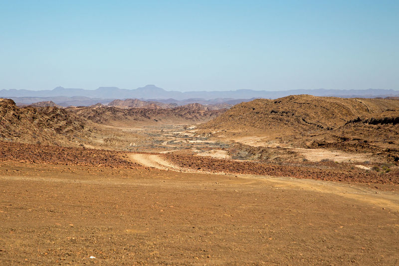 landscape panorama damaraland Namibia africa Africa Blue Sky Damaraland Desert Landscape Mountain Namibia Nature Safari Scenery Scenic Landscapes Groves Panorama Travel Wildlife & Nature Stones Toursm Holidays Vacations Road Sand Sandroad No People Clear Sky Beauty In Nature