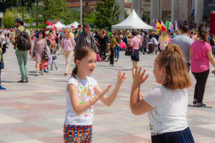 Kids Day Playing Games Cityscape Skenderbeu Square Tirana Albania people and places Gathering Gather & Celebrate Large Group Of People Mixed Age Range Multi Colored City Togetherness Women Child Fun Childhood Coordination Entertainment Reunion - Social Gathering Office Park
