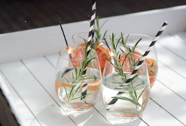 Celebration Coctails Drinking Glasses Party Time! Refreshment Rosemary Alcoholic Drink Close-up Cold Beverages Cold Drink Day Drink Drinking Glass Drinking Straw Food And Drink Freshness Grapefruit High Angle View Leaf No People Refreshment Rosemary Herb Sparklers Table Mix Yourself A Good Time