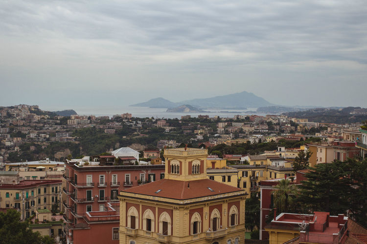 Building Building Exterior Building Story Built Structure City City Life Cityscape High Angle View Horizon Horizon Over Land Italy Lifestyles Mountain Mountain Range Mountain View Mountains Napoli Old Buildings Old Town Sea Seaside Sky Sky And Clouds Travel Traveling