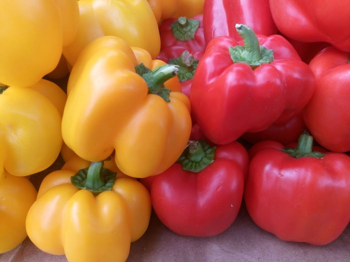 Full frame shot of red bell peppers for sale