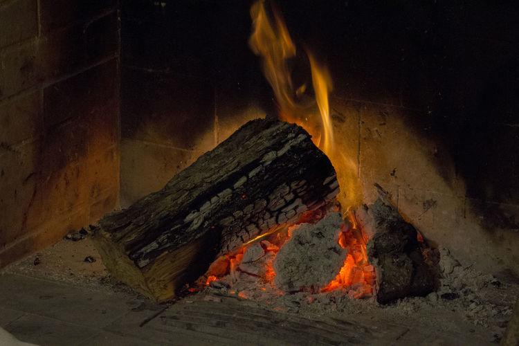 Close-up of burning firewood at night