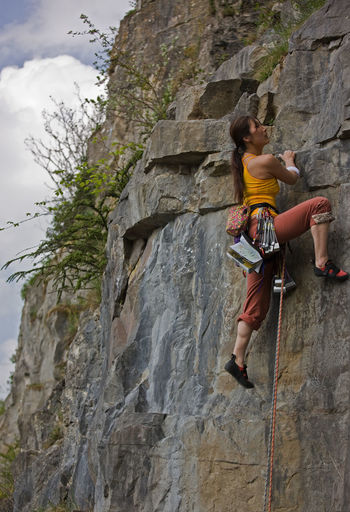 Low angle view of person on rock