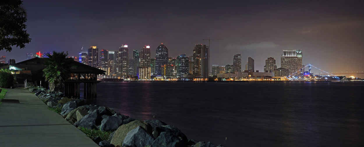 Combined 2 photos to create a panorama of the city from Harbor Island with a canon T3i camera at night time. 2017 April 2017 California San Diego Bay Bridge, Coronado Bridge, Arch Vehicle Bridge, San Diego, California, San Diego City In Background Canon Photography Canon T3i Late Night Stroll By The Bay Panorama View T3i Team Awesome's Late Night Adventures Summer In The City