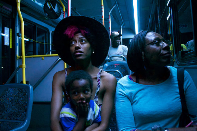 Family Bus Ride. Bus Rides Nightphotography Nighttime Nikon North Carolina Art Bonding Built Structure Childhood Outdoors Photography Real People Sitting Togetherness Young Adult Young Women The Traveler - 2018 EyeEm Awards The Portraitist - 2018 EyeEm Awards