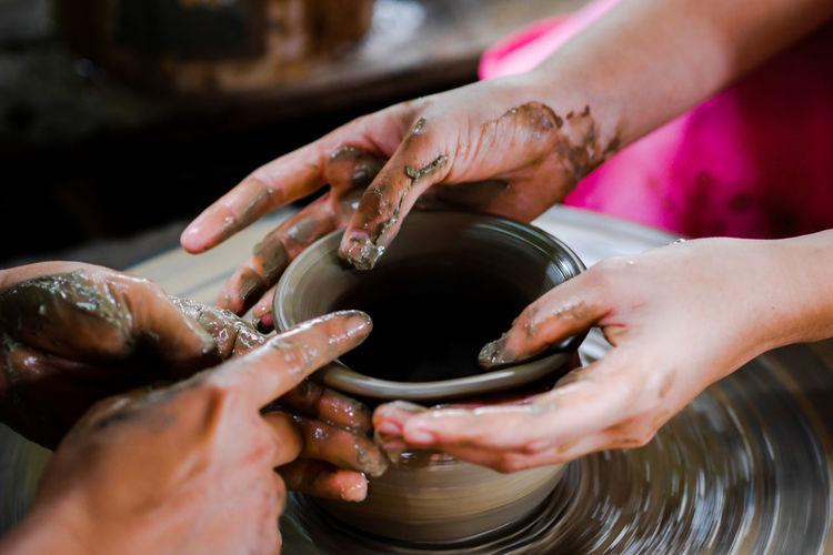 People working on pottery wheel