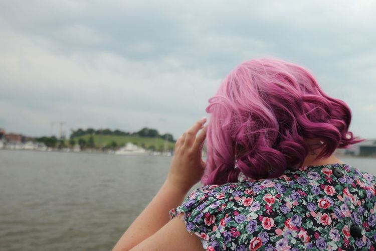 Woman with pink hair and colorful dress looking out to Baltimore harbor Inner Harbor Baltimore Maryland Real People One Person Lifestyles Rear View Leisure Activity Water Women Day Sky Focus On Foreground Nature Adult Headshot Cloud - Sky Outdoors Pink Color Hair Hairstyle Human Hair Floral Pattern