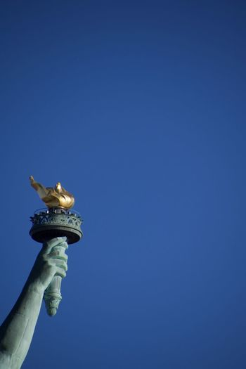 Liberty Blue Clear Sky Close-up Day Gold Gold Colored Human Body Part Human Hand Human Representation Low Angle View Outdoors People Sculpture Sky Statue Travel Destinations The Traveler - 2018 EyeEm Awards