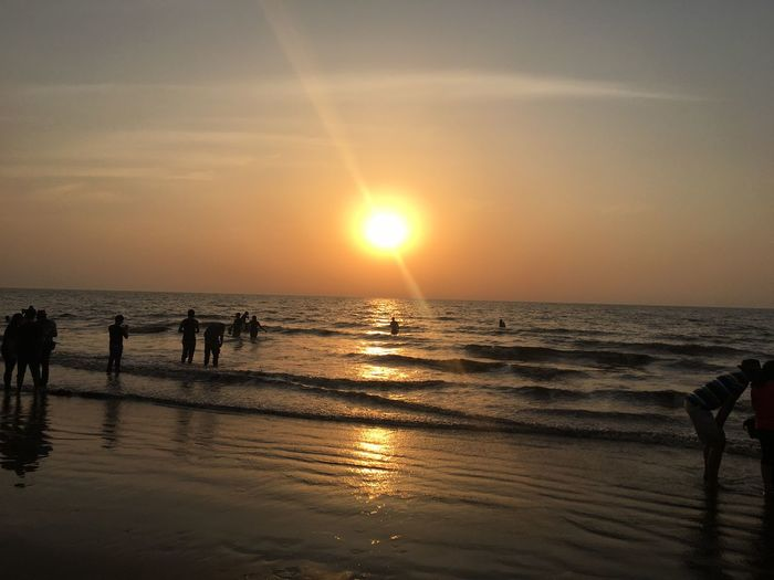 Sunset an the sea Beach Sunset Sea Water Horizon Over Water Nature Beauty In Nature Scenics Reflection Sun Shore Silhouette Sunlight Summer Outdoors Sky Tranquility Sand People Adult
